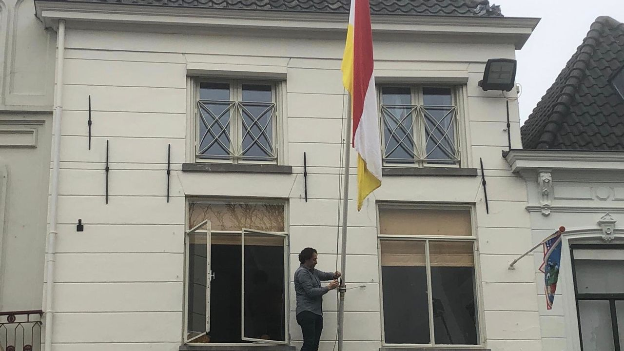 Oeteldonk laat zich op 11-11 niet uit het veld slaan: sjaals en vlaggen sieren de stad